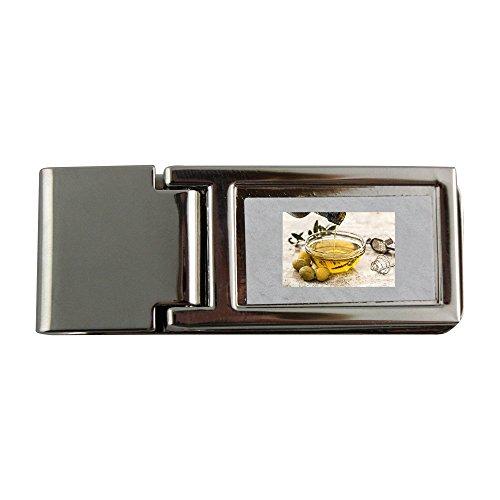 Metallo fermasoldi con olio d' oliva, insalate, cucinare