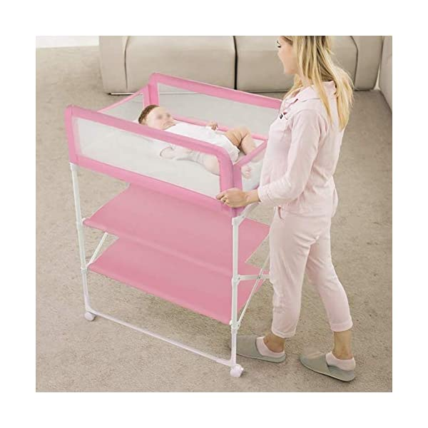 Changing Table Foldable Baby Diaper Changing Table,Movable Baby Changing Station with Safety Strap and Fence Baby Bath Table Dresser Unit Organizer (Color : Pink, Size : B) Changing Table ●Foldable changing table- Easily fold it if you finish all the tasks,With its space saving design, you can store it behind a door, it will make life a little easier for parents. ●Size and Safe and Stable- 80x 50 x 107cm,Suitable for babies weighing less than 25kg,With seat belt,Changing pad has a restraining strap for added safety and is made of easy to clean, soft ●2-in-1 design: Baby changing table can be used as baby massaging table as well. It is designed at the proper height of parent to prevent mom's back aches and pains from kneeling or bending when changing diapers to babies. 7
