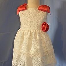 Vestido de celebración de lino beige con detalles rosas