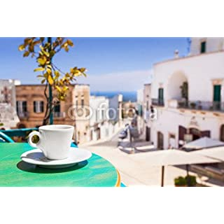 A Cup Of Coffee on Table with Italian Town at the background (73190900), Aluminium-Dibond, 140 x 90 cm