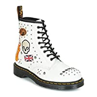 A more rock 'n' roll version of the classic Dr Martens 1460 boots and inspired by the fashion of the first youth subculture, Rockabilly. This collection has added studs and embellishments to the classic DM'S 1460 boots, featuring skull, heart...