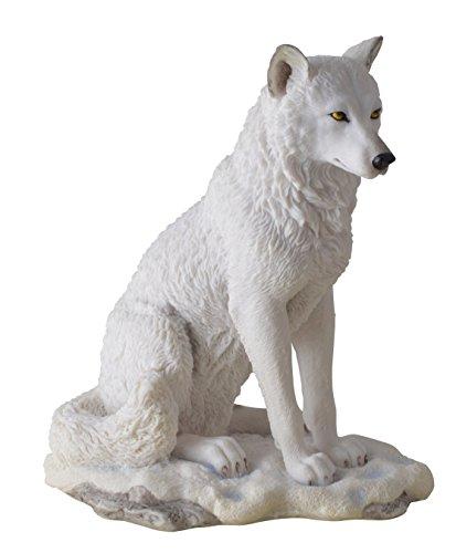 Weißer Wolf Figur sitzend weisser Wolf Polarwolf sitzt im Schnee Wolfsfigur