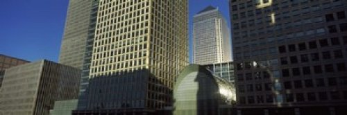 The Poster Corp Panoramic Images - Low angle view of towers Canary Wharf Tower South Quay Isle of Dogs London England Photo Print (91,44 x 30,48 cm)