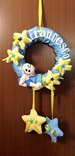 Fiocco nascita personalizzato per bambino con nome, stelline e neonato.