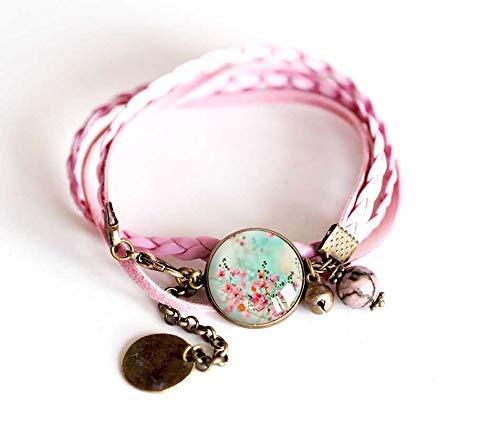 Pulsera cordón rosa, cabujón azul y flores de color rosa pastel, bronce