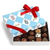 Confiserie Sprüngli Limmat: feinste Variationen von Trüffel und Pralinen, liebevoll gestaltete Geschenksverpackung, 21 Stück