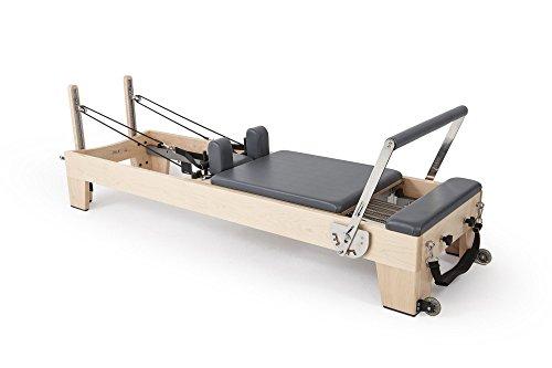 Elina pilates. reformer elite - macchina pilates di alta gamma. progettata da e per professionisti di pilates provenienti da tutto il mondo. primo reformer di legno impilabile sul mercato.
