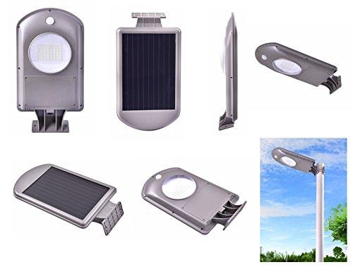 EMEBAY - Etanche 64 LED 5W Super blanc Éclairage solaire extérieur / Lampe solaire LED sans fil d'urgence, de sécurité et de jardin avec Détecteur de mouvement / 6500K / IP65 / PIR / Installation sur mur ou lampadaire / Taille large: 367*205*55mm