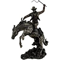 Bronzato Rodeo cowboy and Bucking Bronco statua, altezza 33 cm.