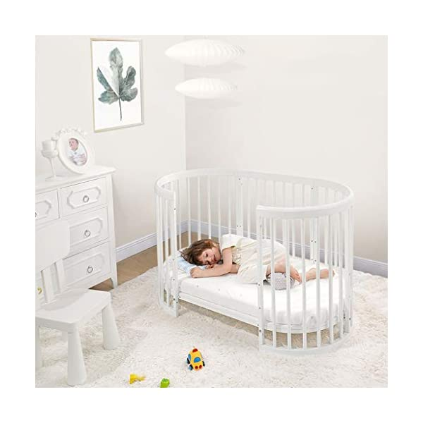 DUWEN-Cot bed Solid Wood Multifunction Baby Cot European Style Cot Bed Toddler Bed Splicing Bed Round Bed With Wheel (color : White) DUWEN-Cot bed 1. This multi-functional crib is made of environmentally-friendly eucalyptus, which is tough and durable, not easy to crack, bearing more than 80KG, green non-toxic paint, healthy and environmentally friendly, non-irritating, harmless to the baby, mother can buy with confidence 2. The three pedestal positions of the crib are suitable for the baby's growth stage, improving visibility and ventilation in all directions, selecting the gear according to the baby's body and age, making the space bigger and more comfortable to use. 3. Multi-functional crib can be easily converted into a game bed, sofa bed, writing desk, designed for healthy sleep of 0-6 years old baby (additional function can be used up to 6 years old), 55mm safety standard guardrail spacing, children's hands and feet will not be Stuck 5