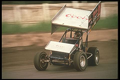 273024 An Outlaw Sprint Car Driver Aggressively Attacks A Corner