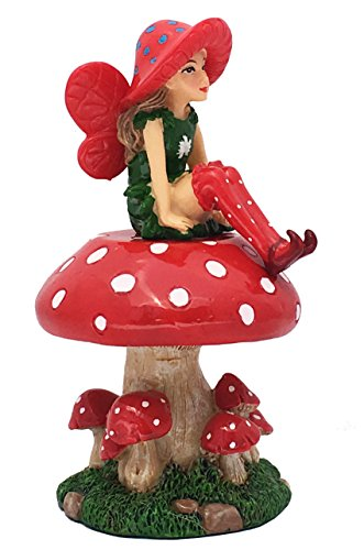 Lulu el Hada en miniatura viste un sombrero brillante con lunares rojos y blancos y lleva calcetines y zapatos a juego. Lleva un precioso vestido de hojas verdes con flores blancas y unas hermosas alas de hada rojas. Lulu se sienta en su Seta Mágica ...