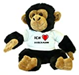 Schimpanse Plüschtier mit einem T-shirt mit Aufschrift Ich Liebe Dobermann (Hunderasse)