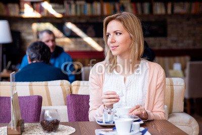 Wunschmotiv: Woman in cafe drinking coffee, enjoying her espresso #118234080 - Bild als Foto-Poster - 3:2-60 x 40 cm/40 x 60 cm