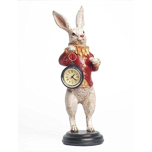 ninchen Figur hält eine Arbeiten Uhr/Uhr. ähnelt dem Charakter aus Alice im Wunderland. (Charaktere Aus Alice Im Wunderland)