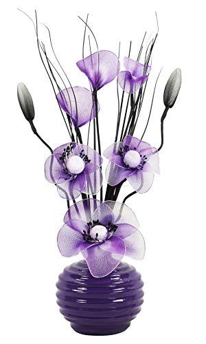 Composizione floreale artificiale in un vaso, porpora