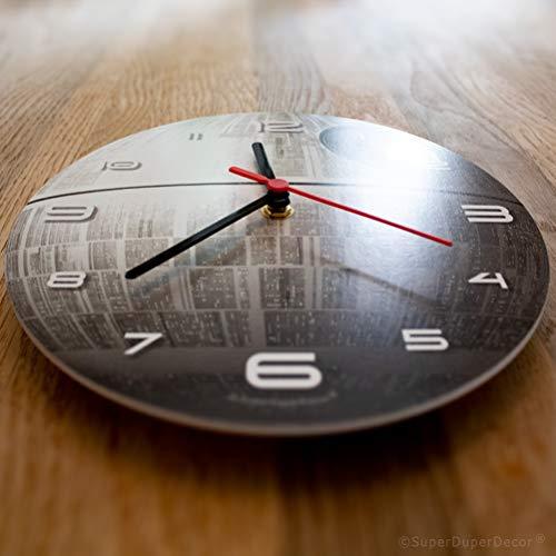 411PnxkZVHL - Reloj de pared de SuperDuperDecor, con diseño de la Estrella de la Muerte de la saga de La Guerra de las Galaxias, brilla en la oscuridad