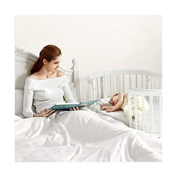 DUWEN-Cot bed Solid Wood Multifunction Baby Cot European Style Cot Bed Toddler Bed Splicing Bed Round Bed With Wheel (color : White) DUWEN-Cot bed 1. This multi-functional crib is made of environmentally-friendly eucalyptus, which is tough and durable, not easy to crack, bearing more than 80KG, green non-toxic paint, healthy and environmentally friendly, non-irritating, harmless to the baby, mother can buy with confidence 2. The three pedestal positions of the crib are suitable for the baby's growth stage, improving visibility and ventilation in all directions, selecting the gear according to the baby's body and age, making the space bigger and more comfortable to use. 3. Multi-functional crib can be easily converted into a game bed, sofa bed, writing desk, designed for healthy sleep of 0-6 years old baby (additional function can be used up to 6 years old), 55mm safety standard guardrail spacing, children's hands and feet will not be Stuck 12
