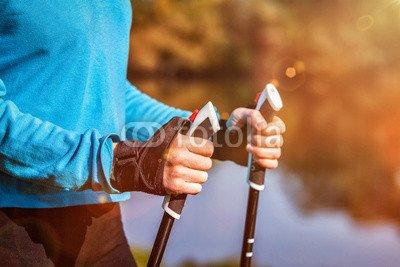 druck-shop24 Wunschmotiv: Closeup of woman's hand holding nordic walking poles #118915394 - Bild auf Alu-Dibond - 3:2-60 x 40 cm/40 x 60 cm