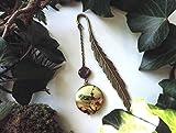 """Marque-pages""""plume à l'oiseau"""", perle en verre de bohême rouge, pendentif pouvant s'ouvrir."""