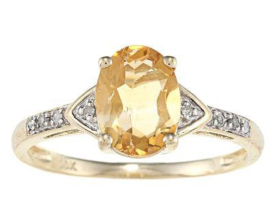 10k Yellow Gold Oval Citrine and Diamond Ring (1/10 TDW) - size 6