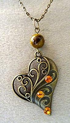 pendentif coeur bronze oeil de tigre cristal autrichien