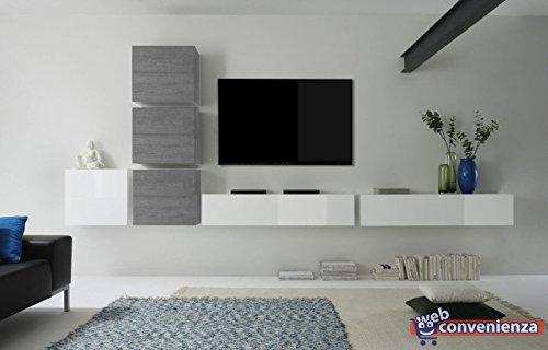parete attrezzata a muro bianca e grigia con tv, decorata con vaso di fiori.