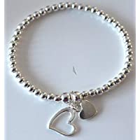 Silver Colour Round Beads With Heart Charms Stretchable Bracelet
