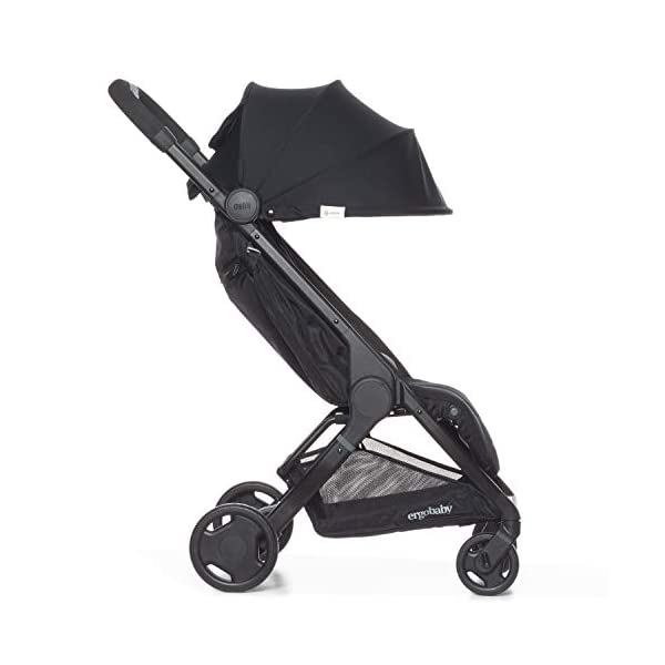 ErgobabyMetro Lightweight Buggy Stroller Pushchair with Sun-Shade Canopy One Hand Foldable, 6Months to 18kg Toddler (Black) Ergobaby A stroller that knows no limits. The ErgobabyMetro Strollers are ultra compact and fits effortlessly into small car boots and most aeroplane luggage compartments. An ideal baby and infant travel system. Baby comfort without compromise - soft, comfortable Stroller packed with plush, cushy padding that supports baby's head, back, bottom and legs . Advanced multi-zone support, and an adjustable footrest give your baby a comfortable seat. The gentle suspension and the shock absorbing PU tyres effortlessly tackle challenges such as kerbs, cobblestones and paving stones. Padded handle and strap. Storage tray for bags and shopping. 6