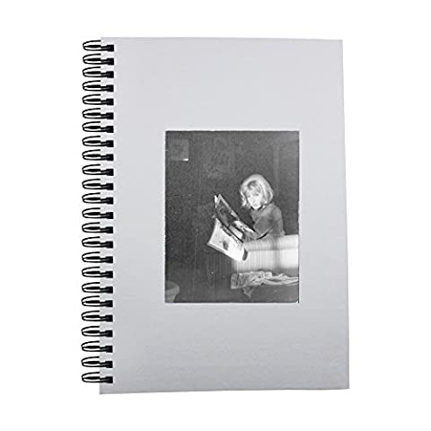 Notebook with Monica Vitti looking up from
