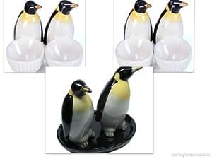 un kit du petit dejeuner du pingouins :Salière et Poivrière - et deux coquetiers du moutons