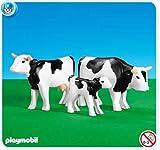 Koeien (zwart/wit) met kalfje