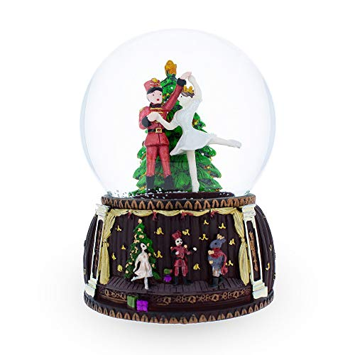 er and Ballerina Dancing Around Christmas Tree Musical Snow Globe ()
