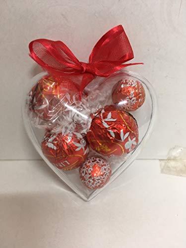 Composizione artigianale san valentino cuore in plex con cioccolatini lindt assortiti.