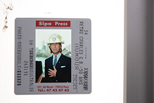 slides-photo-of-prince-charles-being-photographed-wearing-a-safety-helmet-during-australia-tour