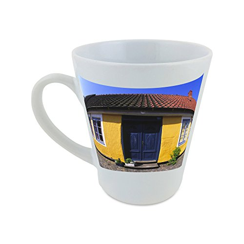 mug-with-fish-eye-view-of-the-facade-of-a-yellow-house-with-potted-plants-kept-on-the-threshold