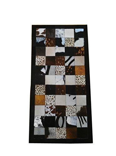 Tappeto pelle di mucca modello patchwork. Misure: 120x60 cms. Realizzato