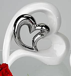 Moderne et tendance vase deco de coeur allongé blanc avec une coeur en argent hauteur 22 cm