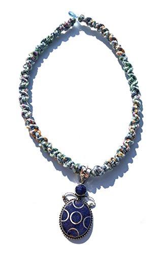 Ethnos Barcelona - Silver pendant and lapis lazuli mosaic.