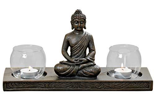 Buddha Figur auf Podest mit 2 Windlichtern