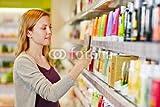druck-shop24 Wunschmotiv: Frau beim Preisvergleich mit Smartphone in Drogerie #69948742 - Bild als Klebe-Folie - 3:2-60 x 40 cm/40 x 60 cm