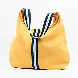 Bolso en loneta gruesa de algodón color amarillo con asas a rayas azul marino y con bolsillos interiores