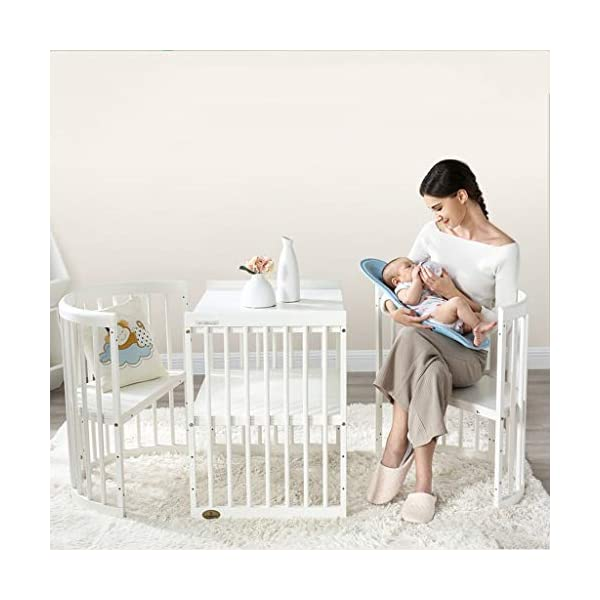 DUWEN-Cot bed Solid Wood Multifunction Baby Cot European Style Cot Bed Toddler Bed Splicing Bed Round Bed With Wheel (color : White) DUWEN-Cot bed 1. This multi-functional crib is made of environmentally-friendly eucalyptus, which is tough and durable, not easy to crack, bearing more than 80KG, green non-toxic paint, healthy and environmentally friendly, non-irritating, harmless to the baby, mother can buy with confidence 2. The three pedestal positions of the crib are suitable for the baby's growth stage, improving visibility and ventilation in all directions, selecting the gear according to the baby's body and age, making the space bigger and more comfortable to use. 3. Multi-functional crib can be easily converted into a game bed, sofa bed, writing desk, designed for healthy sleep of 0-6 years old baby (additional function can be used up to 6 years old), 55mm safety standard guardrail spacing, children's hands and feet will not be Stuck 4
