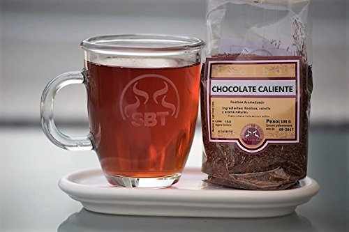 Te Rooibos Hot Chocolate saboreateycafe 100 grammi. Rooibos delizioso mix, cacao, cannella, cardamomo, zenzero, cicoria, pepe e aromi naturali.