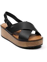 Ideal Shoes - Sandales nacrées à lanières croisées et plateforme Melinda