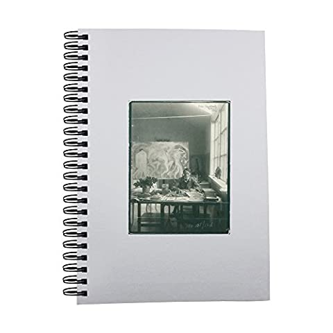 Notebook with John Bauer sitting on chair.