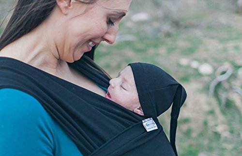Baby Wrap Sling Organic Stretchy Carrier | UK/EU Safety Tested | Made in UK by Joy and Joe ® | Suitable from Birth to 16Kg | With Hat, Bag and Full Colour Instruction (Black) Joy and Joe In each Box, you get your baby sling, matching baby hat, matching bag, full colour user manual (booklet). So you get more value Made in the United Kingdom, Lightweight and super-soft UK/EU safety tested and conform to BS EN. 13209-2:2005 4