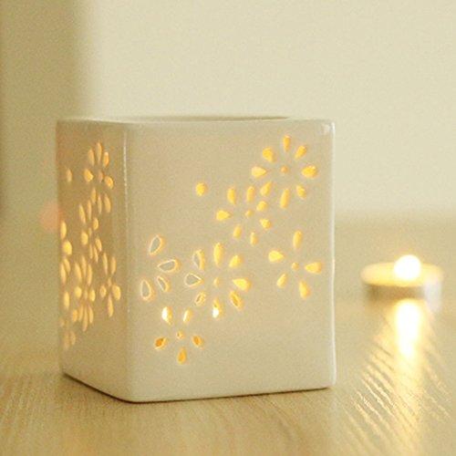 Creativa lampada aromatica forata Debon, in ceramica; colore: bianco latte; motivo: floreale; diffusore di oli essenziali; lampada per aromaterapia; bruciatore d'incenso; forno per candela; portacandele, lumino da tè. B