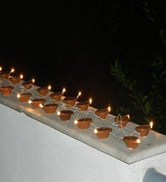 KALAKARINDIA Electric Golden Diya Deepak White Rice Light Lamp For Pooja/Puja/Mandir/Home Decoration for Festivals Diwali/Christmas Home Decoration Light , Diwali Light  available at amazon for Rs.190
