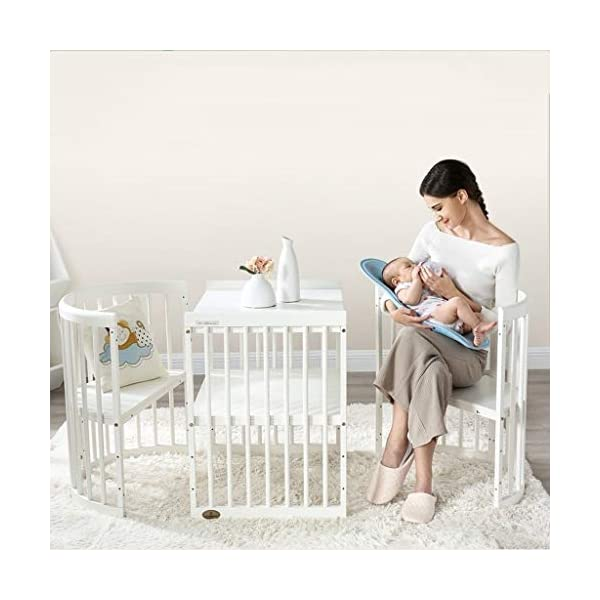 DUWEN Wooden Baby Cot European Multifunctional Small Round Bed Convertible To 3 Positions Toddler Bed Child Bed Sofa Bed Suitable For Cribs Under 6 Years(With Mattress and Bedding) DUWEN 【CONVERTIBLE CRIB】:Easy-to-change 3-in-1 cot can be easily converted from a crib to a nursing table and crib. The versatile crib will provide your child with a comfortable sleep. Beautifully designed cribs can grow with your child from infancy through childhood to adulthood. 【GROW UP WITH YOUR BABY】: The 3-bed mattress height adjustment function on the crib allows you to lower the mattress when your baby starts sitting or standing. It can keep your baby safe and comfortable in the bed that grows up with your baby. This convertible adjustable multifunctional bed will make your child's life unforgettable. 【STURDY PINE WOOD】: The crib is made of high-quality beech wood, which is sturdy and durable, bears more weight, has a carrying capacity of more than 150KG, is easy to assemble, and is designed for the healthy sleep of babies aged 0-6. 3D mousse growth mattress provides babies with comfortable and undisturbed sleep. 5